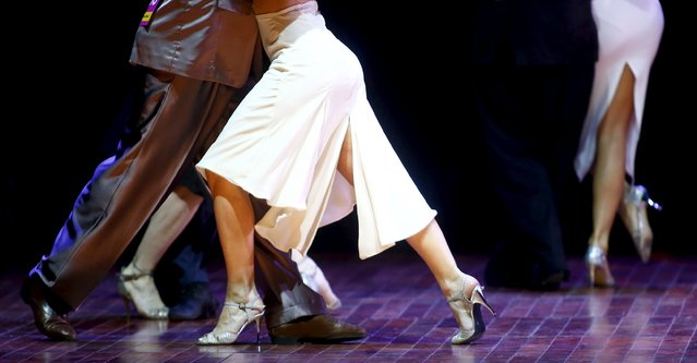 Exequiel Relmuan (L) and Barbara Ferreyra from Argentina, who are representing the city of General Roca, dance during the Salon style final round at the Tango World Championship in Buenos Aires, Argentina, August 26, 2015. (Photo by Marcos Brindicci/Reuters)