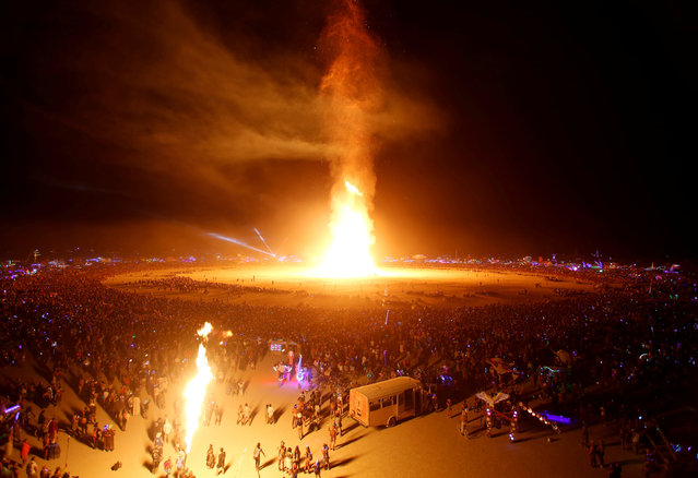 The Man is engulfed in flames as approximately 70,000 people from all over the world gathered for the annual Burning Man arts and music festival in the Black Rock Desert of Nevada, U.S. September 2, 2017. (Photo by Jim Bourg/Reuters)