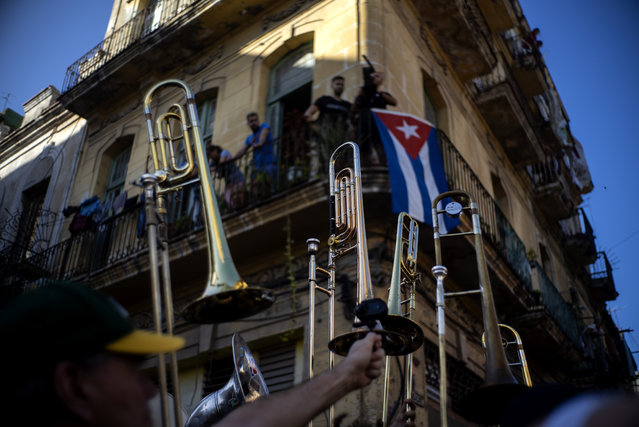 Members of the The Soul Rebels Band from New Orleans raise their instruments to the sky during the music conga through the streets of Old Havana within the activities of the 35th Havana Jazz Plaza festival in Havana, Cuba, Wednesday, January 15, 2020. (Photo by Ramon Espinosa/AP Photo)