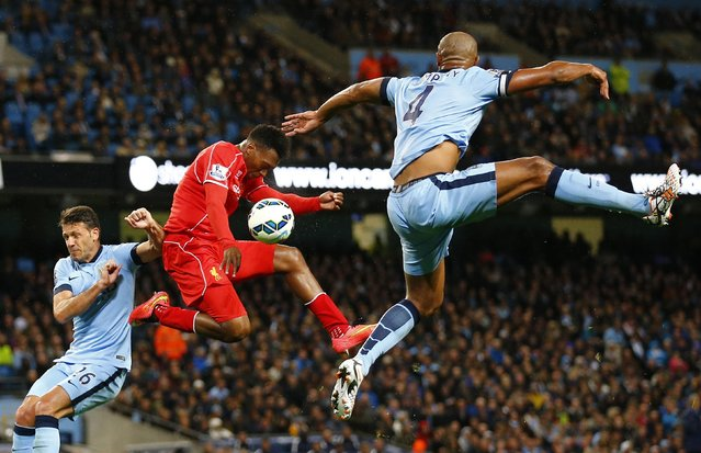 Liverpool's Daniel Sturridge (C) is challenged by Manchester City's Martin Demechelis (L) and Vincent Kompany during their English Premier League soccer match at the Etihad stadium in Manchester, northern England August 25, 2014. (Photo by Darren Staples/Reuters)
