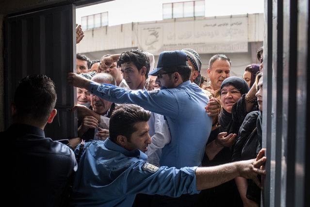 Police and security staff try to keep people from forcing their way into a voting station on September 25, 2017 in Erbil, Iraq. Despite strong objection from neighboring countries and the Iraqi government, some five million Kurds took to the polls today across three provinces in the historic independence referendum. (Photo by Chris McGrath/Getty Images)