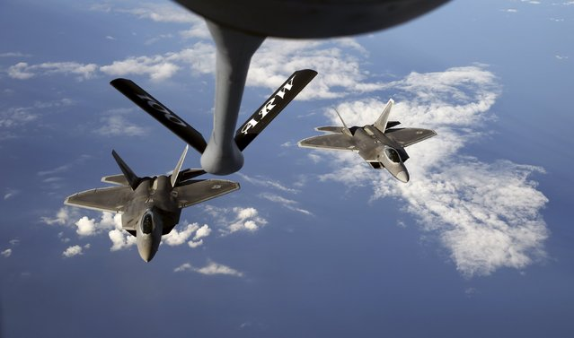 Two F-22 Raptor fighter jets of the 95th Fighter Squadron from Tyndall, Florida approach the refuelling nozzle of a KC-135 Stratotanker from the 100th Air Refueling Wing at the Royal Air Fore Base in Mildenhall in Britain as they fly over the Baltic Sea towards the newly established NATO airbase of Aemari, Estonia September 4, 2015. (Photo by Wolfgang Rattay/Reuters)