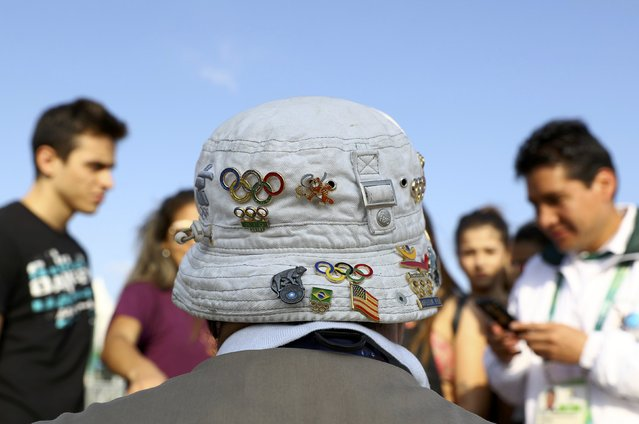 Pin traders gather in Olympic Park ahead of the 2016 Rio Olympics in Rio de Janeiro August 4, 2016. (Photo by Kai Pfaffenbach/Reuters)