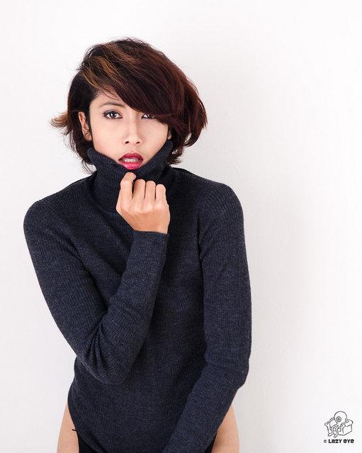 s*xy Asian Beauty. Snug in a Sweater