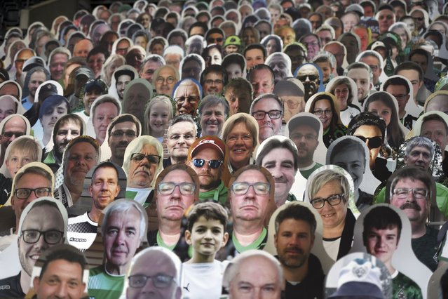 Cardboard pictures of fans are placed in the stands prior to the German Bundesliga soccer match between Borussia Moenchengladbach and Leverkusen, in Moenchengladbach, Germany, Saturday, May 23, 2020. (Photo by Ina Fassbender Pool Photo via AP Photo)