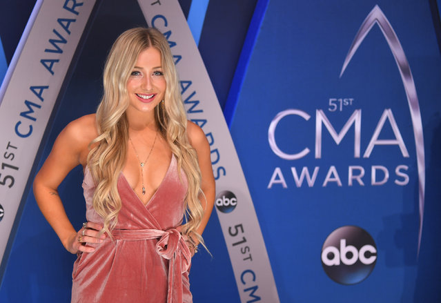 Madeline Merlo pose in the press room at the 51st annual CMA Awards at the Bridgestone Arena on Wednesday, November 8, 2017, in Nashville, Tennessee. (Photo by Harrison McClary/Reuters)