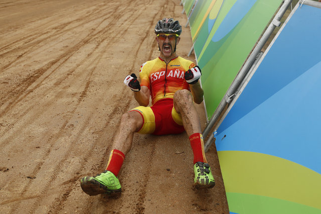 Bronze medalist Carlos Coloma Nicolas of Spain celebrates after finishing third in the cross-country cycling mountain bike race at the 2016 Summer Olympics in Rio de Janeiro, Brazil, Saturday, August 20, 2016. (Photo by Patrick Semansky/AP Photo)