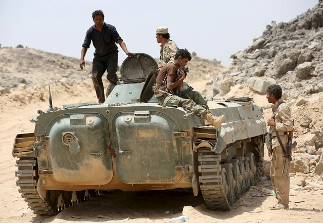 Soldiers loyal to Yemen's government ride on an armoured vehicle in the frontline province of Marib, September 20, 2015. (Photo by Reuters/Stringer)