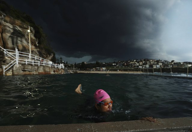 A swimmer swims laps in Bronte Ocean Pool as a severe storm hits Sydney at Bronte Beach on October 13, 2014 in Sydney, Australia. (Photo by Ryan Pierse/Getty Images)