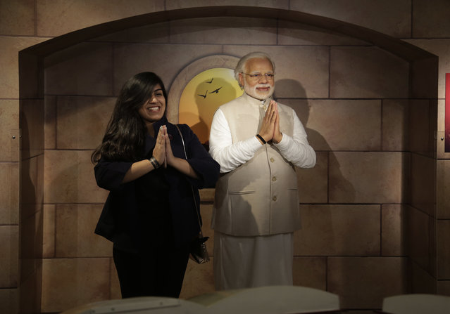 A visitor poses next to a wax figure of Indian Prime Minister Narendra Modi during a press preview of Madame Tussauds Wax Museum in New Delhi, India, Thursday, November 30, 2017. New Delhi's Madam Tussauds museum has become the 23rd Madam Tussauds museum worldwide and will house wax statues of Indian and international icons. (Photo by Altaf Qadri/AP Photo)