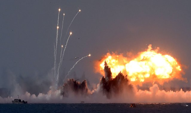 Russia's military jets and navy ships take part in a military exercise called Kavkaz (the Caucasus) 2016 at the coast of the Black Sea in Crimea on September 9, 2016. (Photo by Vasily Maximov/AFP Photo)
