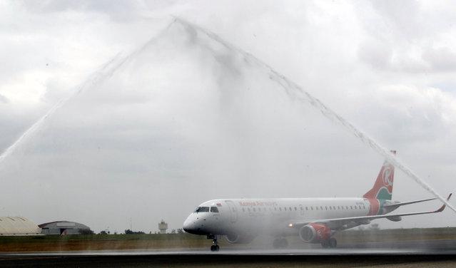 A Kenya Airways plane is received by a water salute as the Jomo Kenyatta international airport reopens after flights were suspended following the coronavirus disease (COVID-19) outbreak in Nairobi, Kenya on August 1, 2020. (Photo by Njeri Mwangi/Reuters)