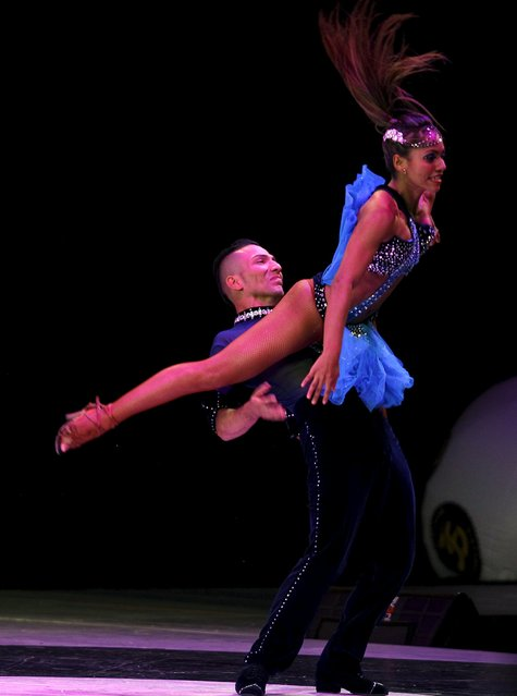 Colombian dancers Angie Duque and Carlos Realpe participate in an exhibition dance during the 10th World Salsa Festival in Cali, Colombia, October 4, 2015. (Photo by Jaime Saldarriaga/Reuters)