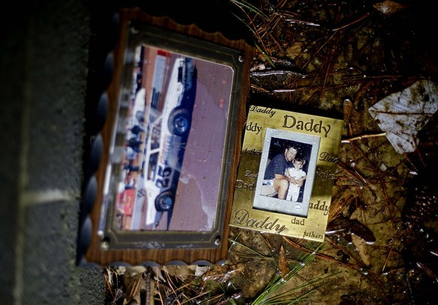 Family photos remain inside a tornado shelter where residents ran from their homes to take cover from the tornado in Adairsville. (Photo by David Goldman/Associated Press)