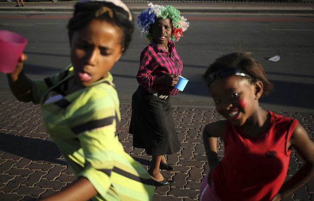 Children react as they celebrate Guy Fawkes day in Soweto, South Africa, on November 5, 2014. (Photo by Siphiwe Sibeko/Reuters)