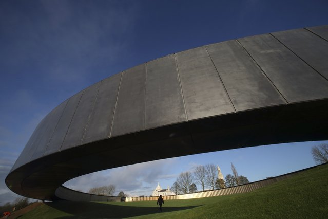 A view shows the new war memorial at Notre Dame de Lorette, an elliptical ring engraved with the names of the 580,000 men who died in northern France during the First World War, in Ablain-Saint-Nazaire November 5, 2014. The memorial, paying respect to fighters of all nationalities who perished in this land between 1914 and 1918, is on the edge of the Notre-Dame de Lorette French war cemetery, itself containing the bodies of over 40,000 soldiers. (Photo by Pascal Rossignol/Reuters)