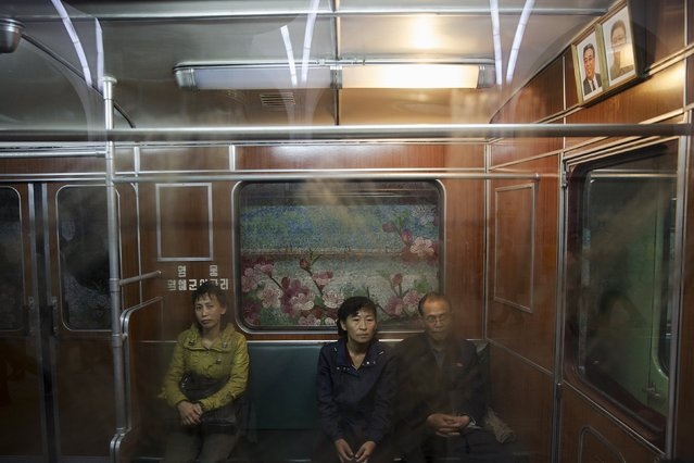 Passengers travel on a train that stopped at a subway station visited by foreign reporters during a government organised tour in Pyongyang, North Korea, October 9, 2015. (Photo by Damir Sagolj/Reuters)