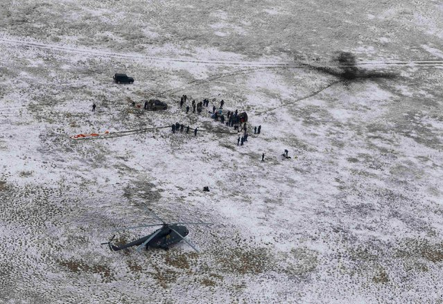 Search and rescue team approaches the Soyuz TMA-13M capsule with the International Space Station (ISS) crew of Alexander Gerst of Germany, Maxim Surayev of Russia and Reid Wiseman of the U.S. after its landing near the town of Arkalyk, in northern Kazakhstan November 10, 2014. (Photo by Shamil Zhumatov/Reuters)
