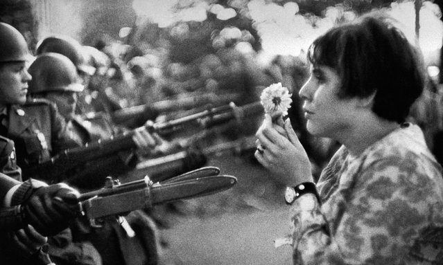 Marc Riboud's image of a young US girl, Jan Rose Kasmir, outside the Pentagon during an anti-Vietnam march, 1967. (Photo by Marc Riboud/Magnum Photos)