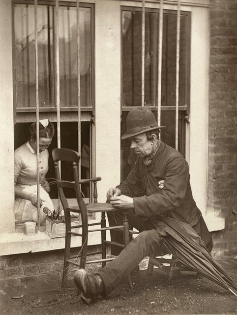 Clown Turned Chair Mender. (Photo by John Thomson/LSE Digital Library)
