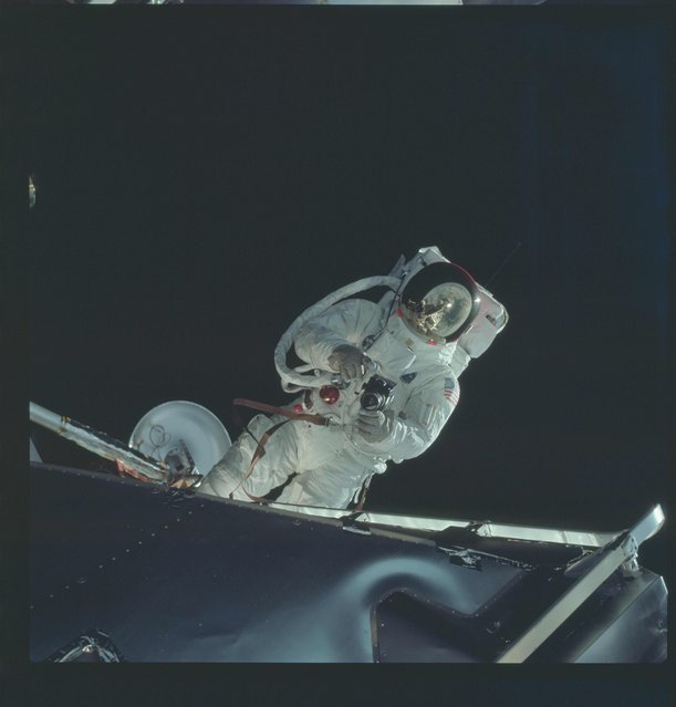 Astronaut Russell L. Schweickart, lunar module pilot, operates a 70mm Hasselblad camera during his extravehicular activity (EVA) on the fourth day of the Apollo 9 Earth-orbital mission in this March 6, 1969 NASA handout photo. (Photo by Reuters/NASA)