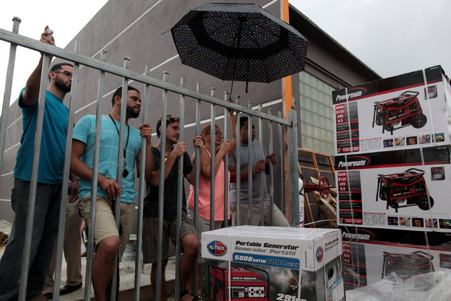 People wait to buy generators during a power outage after a fire at an energy plant knocked out electricity for the bulk of the island, in San Juan, Puerto Rico, September 22, 2016. (Photo by Alvin Baez/Reuters)