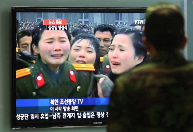 A South Korean soldier watches a television showing North Korean military personnel during their leader Kim Jong Il's funeral at Seoul Railway Station in Seoul, South Korea, Wednesday, December 28, 2011. (Photo by Ahn Young-joon/AP Photo)