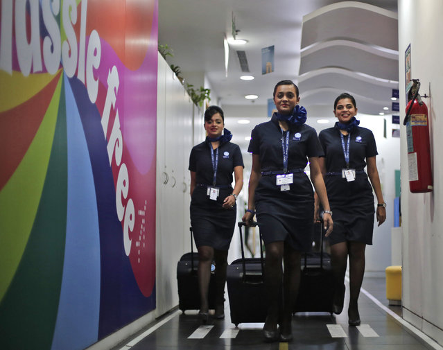 Prospective flight attendants walk on a ramp during their training at the Indigo Airlines' Ifly training centre in Gurgaon on the outskirts of New Delhi November 18, 2014. (Photo by Adnan Abidi/Reuters)
