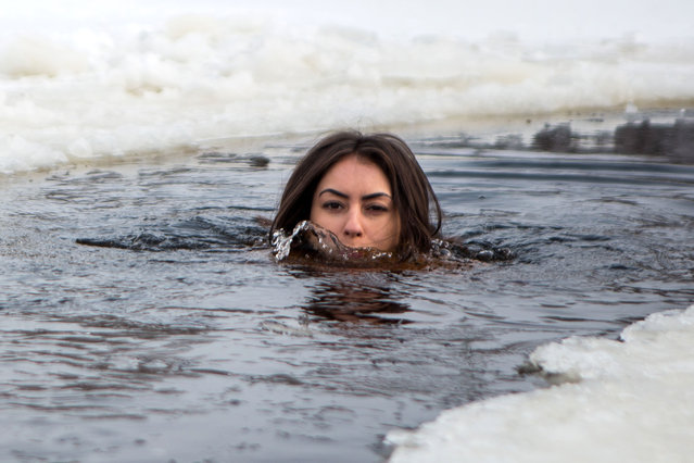 Inna Vladimirskaya skinny dips in one of the coldest rivers in Europe every week. Her swim was captured on camera by Czech photographer David Tensinsky. (Photo by David Tesinsky/Caters News Agency)