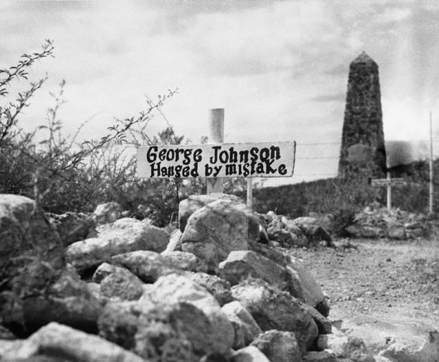 """The rip-roaring days of the Old West are recalled by this big head marker in Boothill Cemetery outside Tombstone, Arizona shown January 3, 1956. The marker reads: """"George Johnson Hanged by Mistake"""". The cemetery was restored after long years in which it had fallen into disrepair. The 259 graves include those of respected citizens and the numerous men and women who died with their boots on during the rowdy days of the early 1880s, when Tombstone was a wealthy mining town. Old records and the memories of old citizens were called on to identify the graves. Boothill got its name from the many outlaws and victims of outlaws who were caught by sudden and violent death, with no time to take off their boots. Whether among these graves was one of a man named Jack Williams, who """"done his damndest"""", is a matter of controversy. Former President Harry S. Truman quoted these words from what he said was Williams' epitaph, in 1952. In a few weeks he plans to visit Boothill. (Photo by AP Photo/EDN)"""