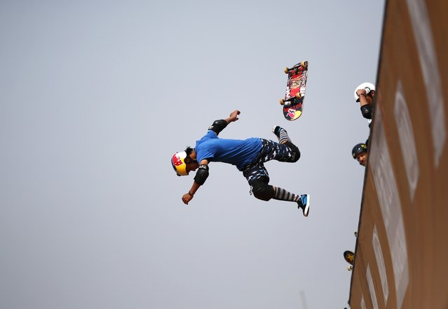 A skateboarder falls as he competes at the Vert Ramp competition during the World Extreme Games in Shanghai in this April 30, 2014 file photo. (Photo by Carlos Barria/Reuters)