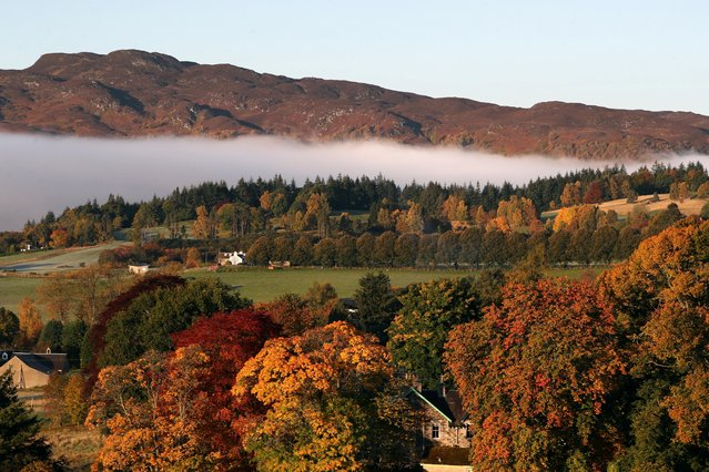 Mist hangs over Pitlochry, Scotland, Britain on October 17, 2020. (Photo by Russell Cheyne/Reuters)