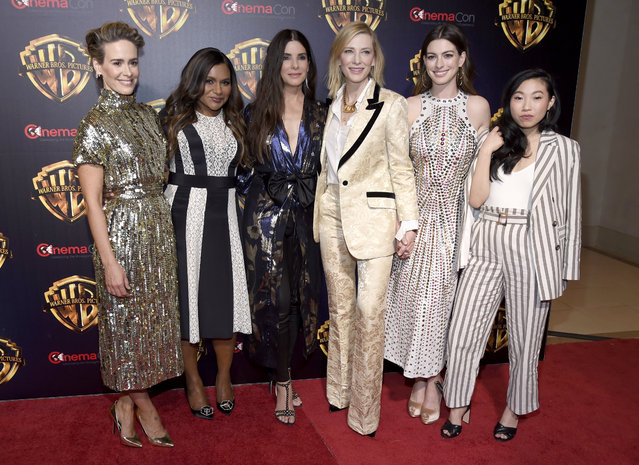 "Sarah Paulson, from left, Mindy Kaling, Sandra Bullock, Cate Blanchett, Anne Hathaway and Awkwafina, cast members in the upcoming film ""Ocean's 8"", arrive at the Warner Bros. presentation at CinemaCon 2018, the official convention of the National Association of Theatre Owners, at Caesars Palace on Tuesday, April 24, 2018, in Las Vegas. (Photo by Chris Pizzello/Invision/AP Photo)"