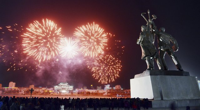 Fireworks explode in the sky over Kim Il-sung Square in Pyongyang in this undated photo released by North Korea's Korean Central News Agency (KCNA) in Pyongyang January 1, 2015. (Photo by Reuters/KCNA)