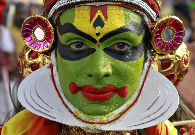 A Kathakali dancer attends the 31st Cochin Carnival at Fort Kochi in the southern Indian city of Kochi January 1, 2015. The Carnival is held annually to welcome the start of the New Year. (Photo by Sivaram V/Reuters)