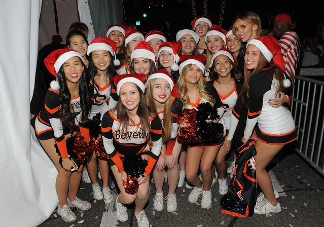 TV host Giuliana Rancic poses with Beverly Hills High School Cheerleaders at the Beverly Hills Holiday Lighting Ceremony on Rodeo Drive on November 22, 2015 in Beverly Hills, California. (Photo by Angela Weiss/Getty Images for Rodeo Drive Committee)