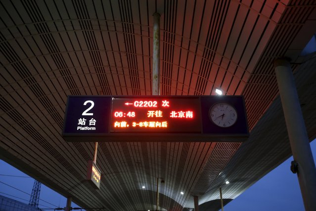 An electronic board displays information on a platform at a railway station in Tianjin, China, November 18, 2015. (Photo by Jason Lee/Reuters)