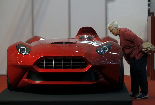 A visitor looks at the Sbarro Miglia concept car at the Essen Motor Show in Essen, Germany, November 27, 2015. (Photo by Ina Fassbender/Reuters)