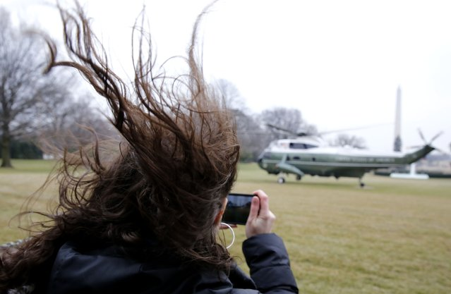 A woman's hair blows as Marine One, carrying U.S. President Barack Obama, takes off from the South Lawn of the White House in Washington, January 21, 2015. Obama is travelling to Idaho and Kansas for two days and is scheduled to return to Washington tomorrow. (Photo by Larry Downing/Reuters)