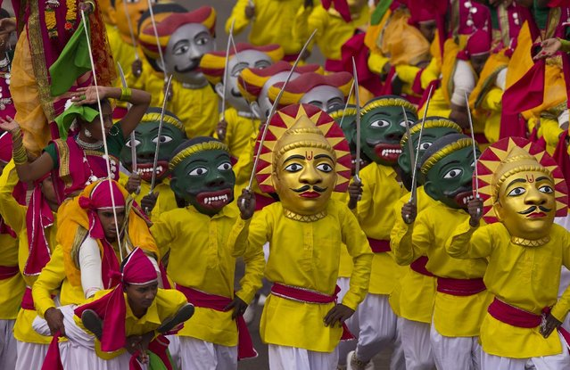 Indian students perform a dance in colorful masks during the full-dress rehearsal of Republic Day parade in New Delhi, India, Friday, January 23, 2015. (Photo by Saurabh Das/AP Photo)