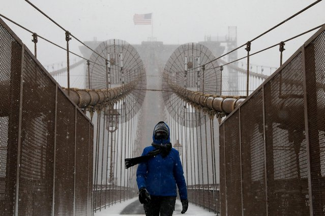 A person walks through the Brooklyn Bridge during a snow storm, amid the coronavirus disease (COVID-19) pandemic, in New York City, New York, U.S., February 1, 2021. (Photo by Brendan McDermid/Reuters)