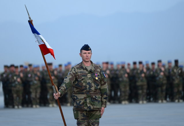 French soldiers stand guard during a ceremony for the French National Day, Bastille Day, at Kabul International Airport in Kabul on July 13, 2013. The French contingent in Afghanistan held a ceremony in Kabul to mark Bastille Day that is held on July 14. France has 500 soldiers in Afghanistan. (Photo by Massoud Hossaini/AFP Photo)