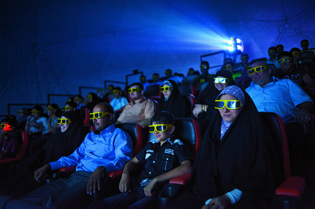 Moviegoers thrill to shaking seats and wind machines during a 3-D film at a theater closed during the war in Baghdad. Iraq, October 2, 2010. (Lynsey Addario/VII Network/National Geographic)