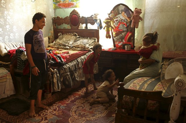 A family talk in their home in the Cairo Necropolis, Egypt, September 14, 2015. (Photo by Asmaa Waguih/Reuters)