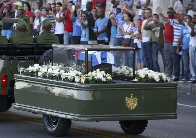 A military vehicle transports the ashes of Cuba's late President Fidel Castro at the start of a three-day journey to the eastern city of Santiago, in Havana, Cuba, November 30, 2016. (Photo by Carlos Garcia Rawlins/Reuters)