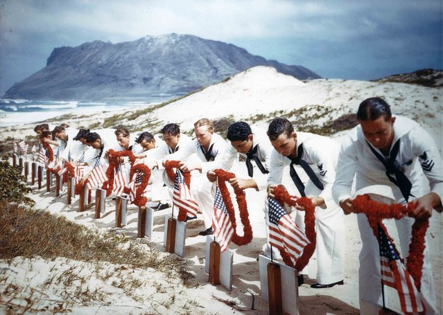 Following Hawaiian tradition, Sailors honor men killed during the Japanese Pearl Harbor attack the previous year on Naval Air Station Kaneohe, Hawaii, U.S. May 31, 1942. The casualties had been buried on December 8, 1941. (Photo by Reuters/U.S. Navy/National Archives)