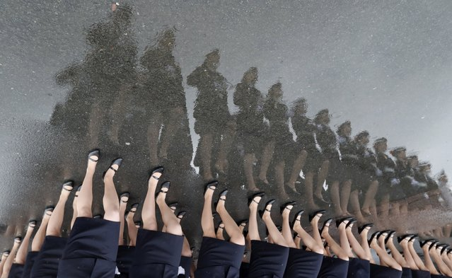 Russian police cadets march during general rehearsal of the Victory Day parade on the Dvortsovaya Square in St. Petersburg, Russia, 07 May 2021. The military parade marking the 76th anniversary of the victory over Nazi Germany in the World War II will take place on the Dvortsovaya Square on 09 May 2021. (Photo by Anatoly Maltsev/EPA/EFE)