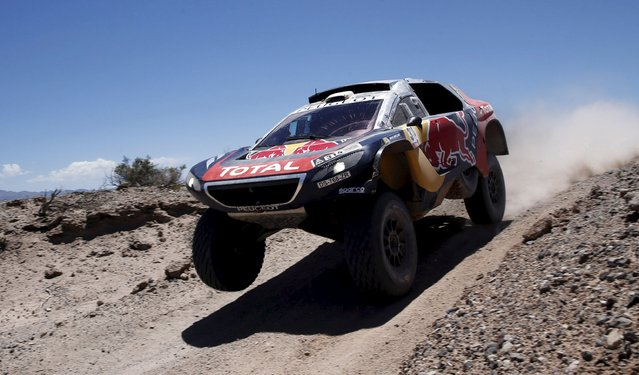 Sebastien Loeb of France drives his Peugeot during the 11th stage of the Dakar Rally near San Juan, Argentina, January 14, 2016. (Photo by Marcos Brindicci/Reuters)