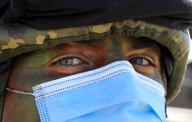"""A Romanian infantry ranger, who wears a protective mask, is seen during the Multinational military exercise """"Justice Sword 21"""" held at Smardan shooting range, 260 kilometers north-east of Bucharest, Romania, 11 May 2021. Multinational military exercise """"Justice Sword 21"""" is a real-life tactical LIVEX tactical exercise aimed to improve the ability to plan, lead and conduct combat actions in a multinational and united context. At the Justice Sword multinational exercise participate more than 2,000 soldiers and about 500 technical means and fighting machines from the Romanian Land Forces took part, with the support of a Polish infantry company from the South-East Multinational Brigade from Craiova and from the Romanian Air Force. (Photo by Robert Ghement/EPA/EFE)"""