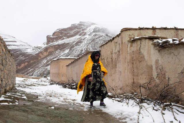 A woman walks through the snow covered village of Tilmi in the High Atlas region of Morocco February 13, 2015. (Photo by Youssef Boudlal/Reuters)